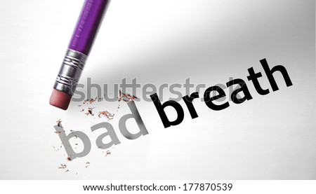 Eraser deleting the words Bad Breath - stock photo