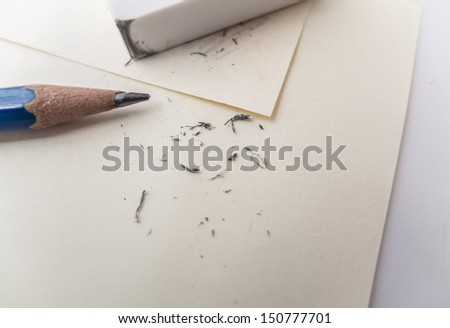 eraser removing a written mistake on a piece of paper - stock photo