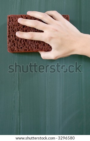 Erasing the Blackboard - stock photo