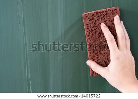 Erasing the Chalkboard - stock photo