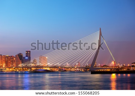 Erasmus Bridge (Erasmusbrug) at twilight in the city centre of Rotterdam, Netherlands, South Holland province. - stock photo
