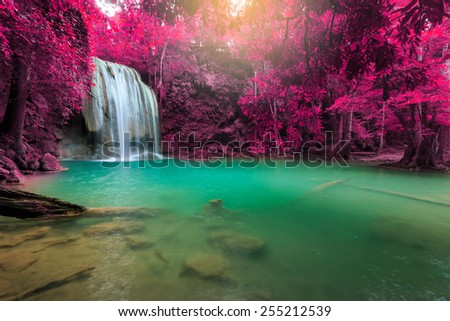 Erawan Waterfall, beautiful waterfall with sunlight rays in deep forest, Erawan National Park in Kanchanaburi, Thailand - stock photo