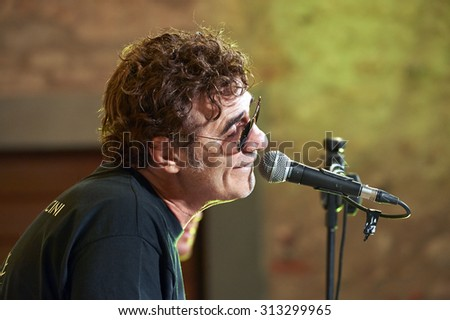 "ERBUSCO,ITALY - AUGUST 29:  exhibition live of the  italian songwriter francesco Baccini at the event ""Acoustic Franciacorta 2015"",29 August ,2015 in Erbusco,Italy"