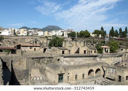 ERCOLANO, ITALY-JUNE 24, 2015: the archeological site of Ercolano, the Roman Emperor's town preserved after the eruption of the Vesuvio volcano on 79dc, in Ercolano. - stock photo