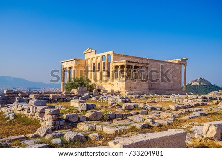 Erechtheion temple in Athens during the sunset. Ruins of the Temple of Erechtheion and Temple of Athene at the Acropolis hill in Greece.