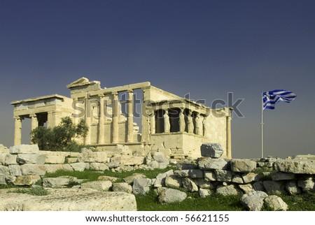 Erechtheum with Greek flag in Acropolis, Athens, Greece - stock photo
