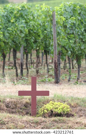 erected Simple brown wooden cross at the roadside