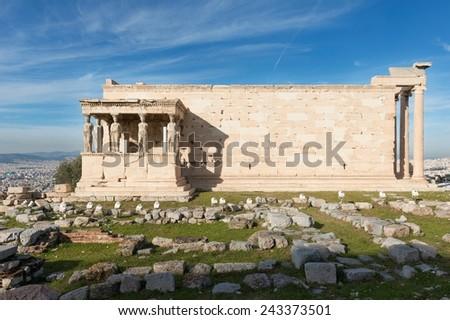 Erectheion temple ruins on the Acropolis in Athens, Greece - stock photo