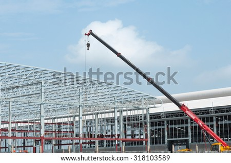 Erection roof truss work with blue sky background. - stock photo