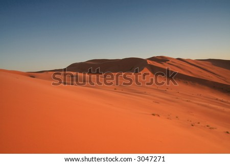 Erg Chebbi sand dunes in the Sahara Desert near Hassi Labiad and Merzouga, Morocco. Algeria is located 20 km from here. - stock photo