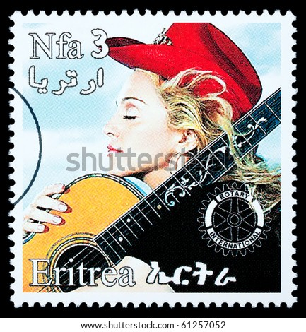 ERITREA - CIRCA 2000: A postage stamp printed in Eritrea showing Madonna Louise Ciccone, circa 2000 - stock photo