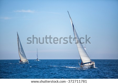 ERMIONI, GREECE - CIRCA MAY, 2014: Sailboats participate in sailing regatta 11th Ellada 2014 among Greek island group in the Aegean Sea, in Cyclades and Argo-Saronic Gulf.