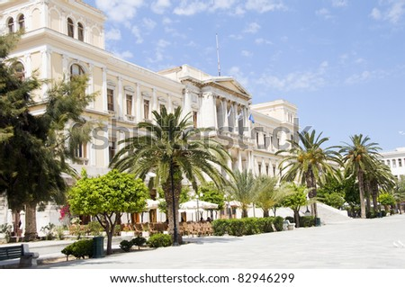 Ermoupolis Town Hall marble streets Syros Island Cyclades Greece with outdoor cafe - stock photo
