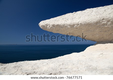 eroded chalk rock detail white stone blue sky and sea beautiful background erosion of cliffs at coastline idyllic tropical paradise for summer vacation geologic rock formation eroded stone