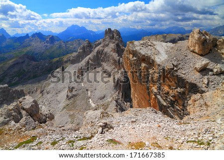 Eroded cliffs under cloudy sky, Dolomite Alps, Italy