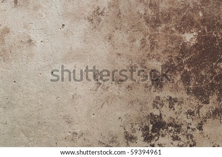 Eroded old plaster at a wall - stock photo