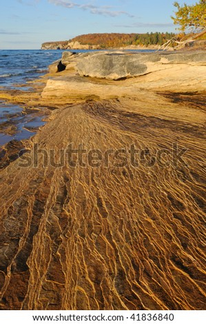 Eroded sandstone shoreline, Lake Superior, Pictured Rocks National Lakeshore, autumn, Michigan's Upper Peninsula, USA