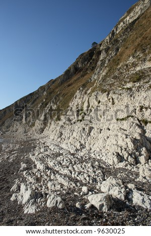 Eroding chalk cliffs in Dorset England. - stock photo