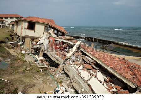 Erosion at seaside resort from climate change situation, wave broken building, very unsafe, danger, environment risk of worldwide when sea level rise by warming, scene at Cua Dai, Hoi An, Vietnam - stock photo