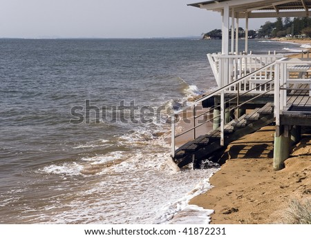 Erosion caused by rising sea levels due to global warming - stock photo