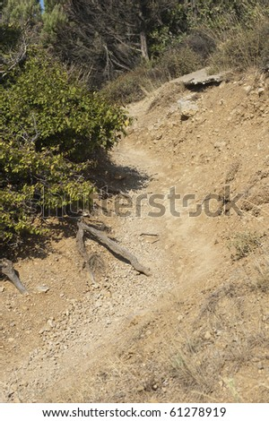 Erosion of trail by walkers, the damaging effect of tourism on the natural environment - stock photo