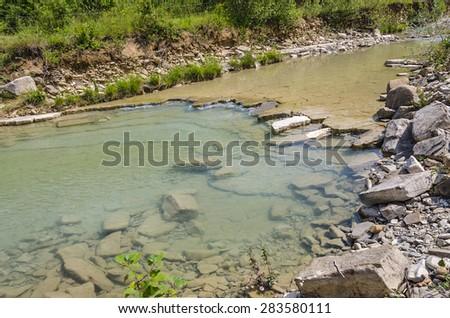 Erosion within river Dragonja - stock photo