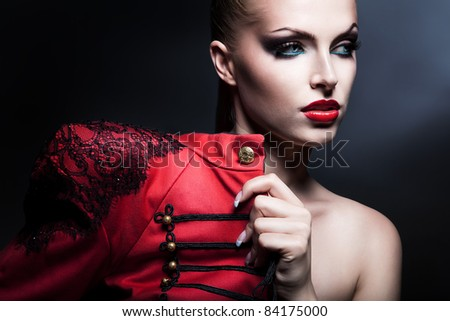 erotic attractive woman in red with blue eyes - stock photo