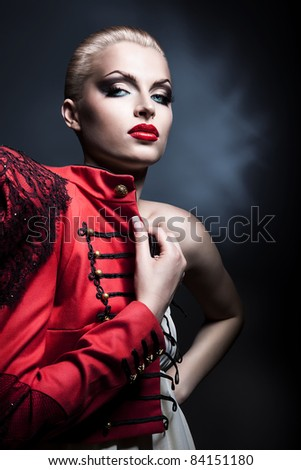 erotic blonde woman in red with red lips