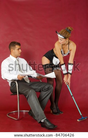 Erotic cleaning at home of business man - stock photo