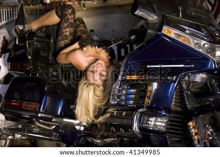 erotic girl on Motobike - stock photo