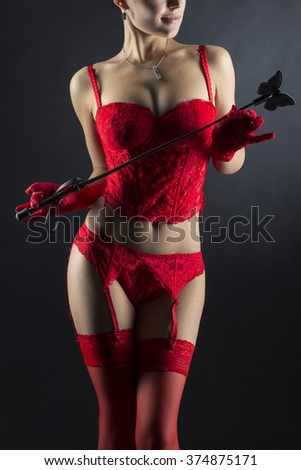 Erotic shot of a girl in red lingerie and stockings, close up shot  - stock photo