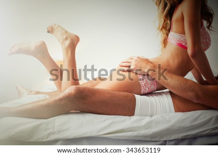 Erotic woman on top of man  - stock photo
