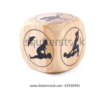 Erotic wooden cube on white background - stock photo