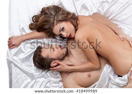 Erotica. Top view of strong man hugs pretty girl