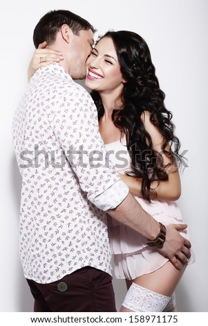 Erotism. Libidinous Flirty Couple Gently Embracing Together - stock photo