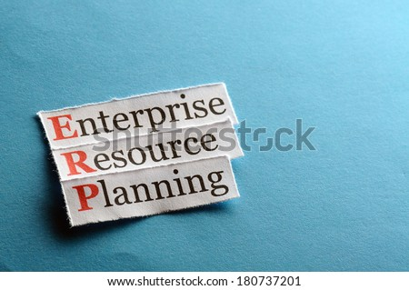 erp - enterprise resource planning on blue paper - stock photo