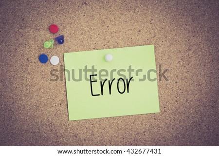 Error written on sticky note pinned on pinboard - stock photo