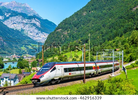 Erstfeld, Switzerland - July 30, 2016: Alstom ETR 610 tilting high-speed train on the Gotthard railway. The traffic will be diverted to the Gotthard Base Tunnel in December 2016.