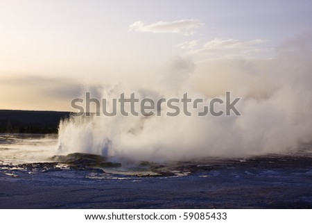 Erupting geyser in yellowstone - stock photo