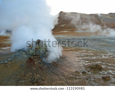 erupting geyser of steam with sulfur deposits, Iceland - stock photo