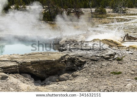 Erupting Geysir in Yellowstone National Park, Wyoming - stock photo