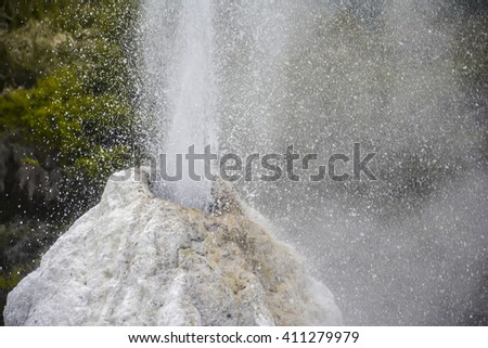 Erupting Lady Knox geiser at Wai-O-Tapu geothermal area in Rotorua, New Zealand - stock photo