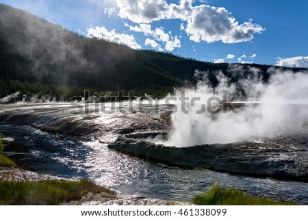 Eruption of Cliff Geyser, Black Sand Basin, Yellowstone National Park, Wyoming, USA.