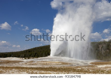 Eruption of Old Faithful geyser at Yellowstone National Park - stock photo