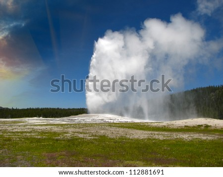 Eruption of Old Faithful Geyser at Yellowstone National Park - USA - stock photo