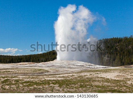 Eruption of Old Faithful geyser - Yellowstone National Park - stock photo