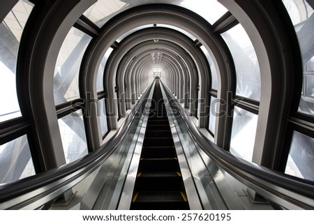 escalator ,abstract space in a modern building - stock photo