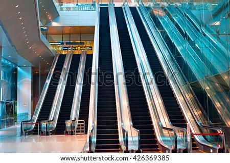 Escalator at Changi international airport in Singapore - stock photo