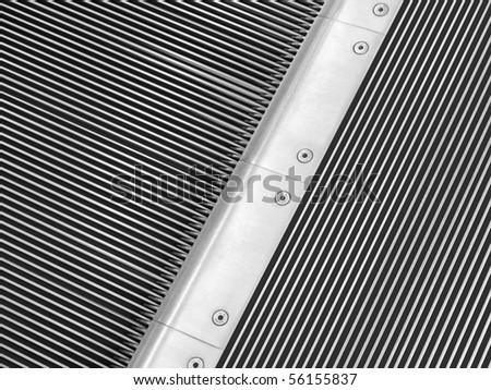 Escalator detail. Start - end of conveyor steps - stock photo