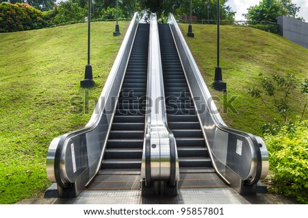 Escalator going to park - stock photo